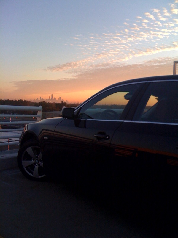 BMW 5 Series watching sunrise over Chicago
